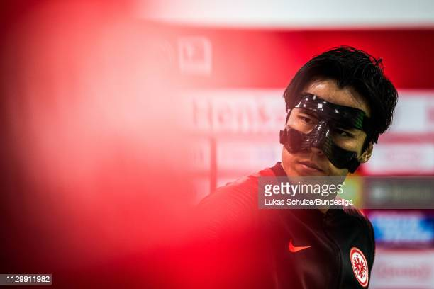 Makoto Hasebe of Frankfurt wears a mask and is focused in the player tunnel prior to the Bundesliga match between Fortuna Düsseldorf and Eintracht...