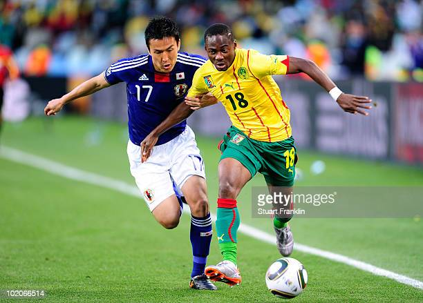 Makoto Hasebe of Japan and Enoh Eyong of Cameroon battle for the ball during the 2010 FIFA World Cup South Africa Group E match between Japan and...