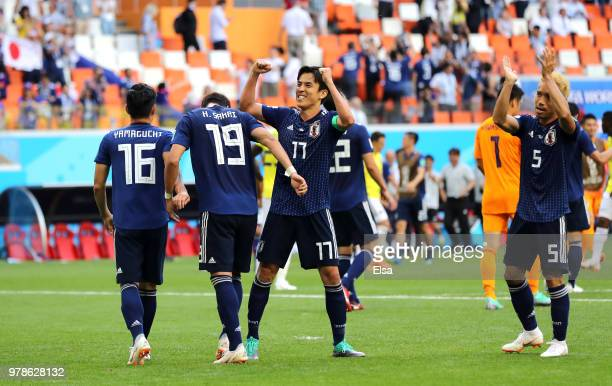 Makoto Hasebe of Japan and Yuto Nagatomo of Japan celebrate after winning the 2018 FIFA World Cup Russia group H match between Colombia and Japan at...