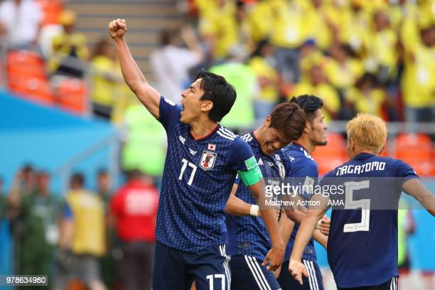 Makoto Hasebe of Japan celebrates with his team-mates at the end of the 2018 FIFA World Cup Russia group H match between Colombia and Japan at...