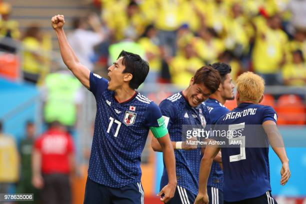 Makoto Hasebe of Japan celebrates with his teammates at the end of the 2018 FIFA World Cup Russia group H match between Colombia and Japan at...