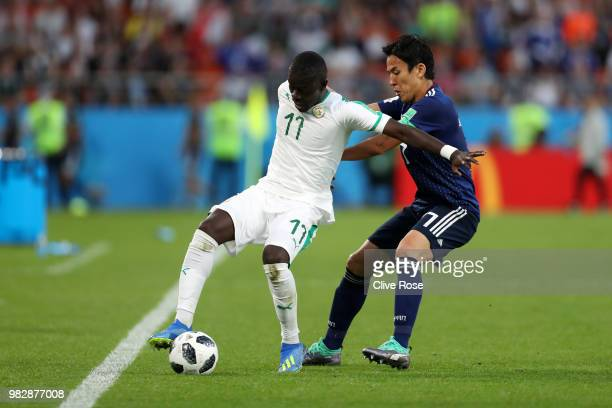 Makoto Hasebe of Japan challenges Pape Alioune Ndiaye of Senegal during the 2018 FIFA World Cup Russia group H match between Japan and Senegal at...