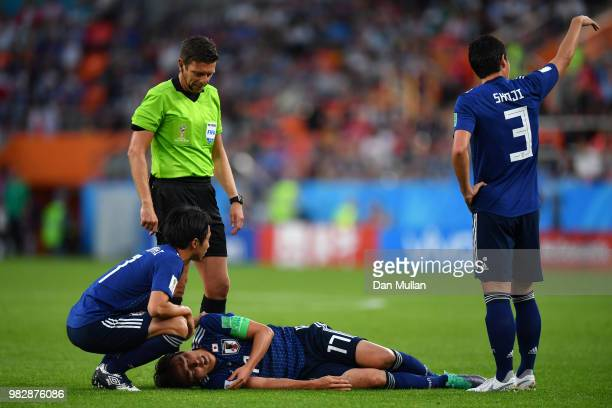 Makoto Hasebe of Japan goes down injured during the 2018 FIFA World Cup Russia group H match between Japan and Senegal at Ekaterinburg Arena on June...