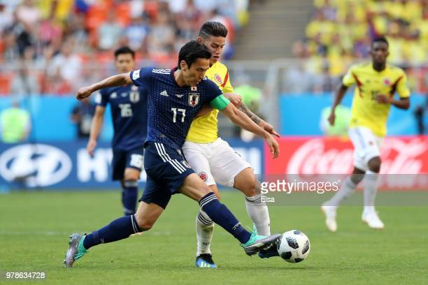 Makoto Hasebe of Japan is challenged by James Rodriguez of Colombia during the 2018 FIFA World Cup Russia group H match between Colombia and Japan at...
