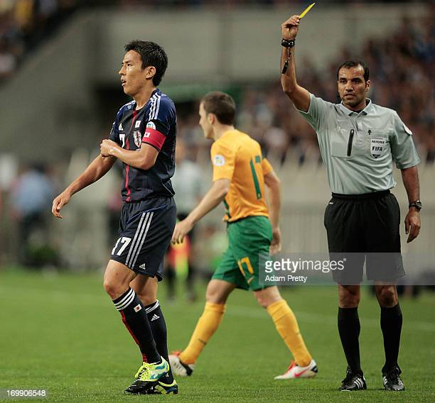 Makoto Hasebe of Japan is given a yellow card during the FIFA World Cup qualifier match between Japan and Australia at Saitama Stadium on June 4 2013...