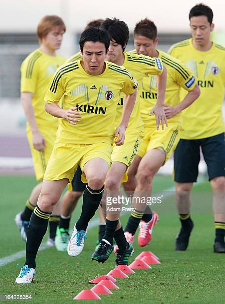 Makoto Hasebe of Japan performs drills during the Japan Football team training session before the International Friendly football match between Japan...