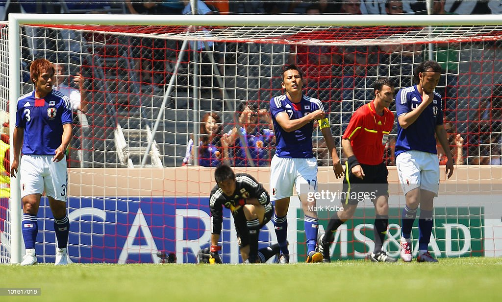 Makoto Hasebe of Japan reacts after a goal during the Japan v Ivory Coast International Friendly match at Stade de Toubillon on June 4, 2010 in Sion, Switzerland.