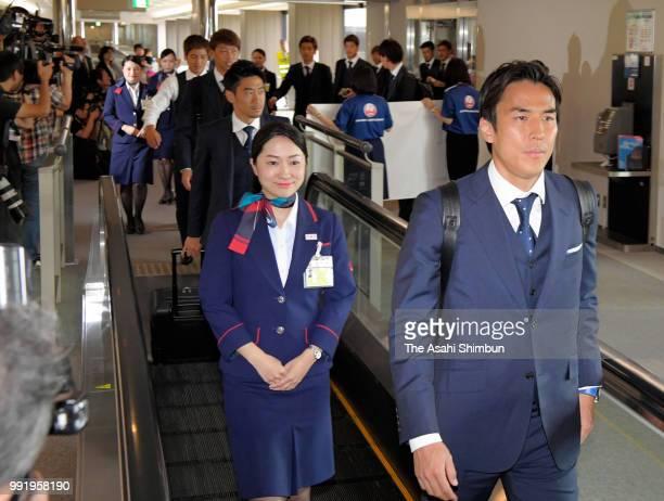 Makoto Hasebe of Japan smiles on arrival at Narita International Airport after the FIFA World Cup on July 5 2018 in Narita Chiba Japan