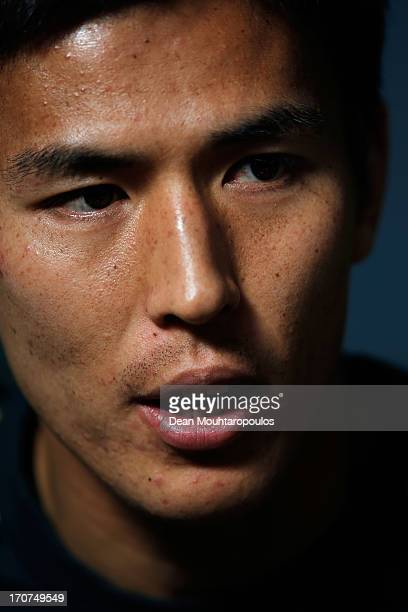 Makoto Hasebe of Japan speaks to the media after the Japan Training Session at the Confederations Cup 2013 at Centro de Capacitacao Fisica dos...