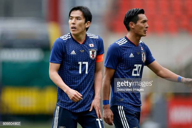 Makoto Hasebe of Japan Tomoaki Makino of Japan during the International Friendly match between Japan v Ukraine at the Stade Maurice Dufrasne on March...