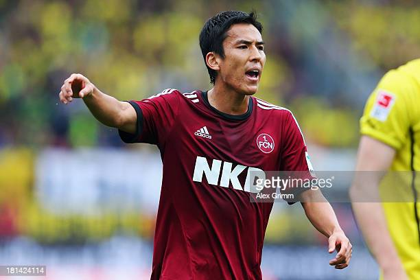 Makoto Hasebe of Nuernberg reacts during the Bundesliga match between 1. FC Nuernberg and Borussia Dortmund at Grundig Stadium on September 21, 2013...
