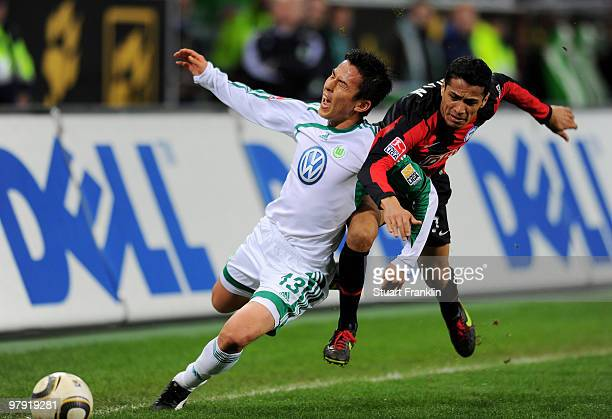 Makoto Hasebe of Wolfsburg and Cicero of Berlin battle for the ball during the Bundesliga match between VfL Wolfsburg and Hertha BSC Berlin at...
