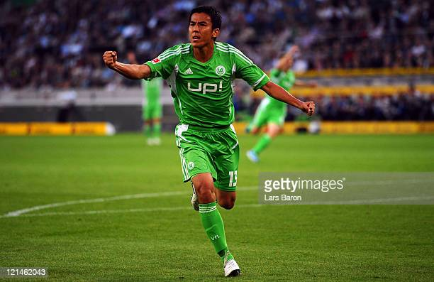 Makoto Hasebe of Wolfsburg celebrates after scoring his teams first goal during the Bundesliga match between Borussia Moenchengladbach and VfL...