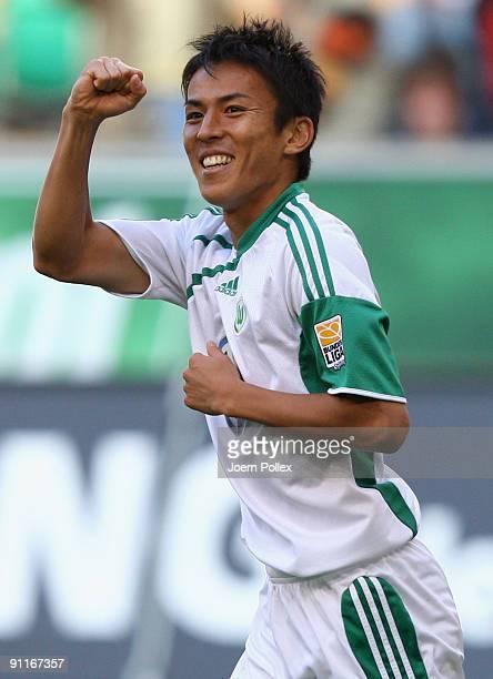 Makoto Hasebe of Wolfsburg celebrates after scoring his team's third goal during the Bundesliga match between VfL Wolfsburg and Hannover 96 at...