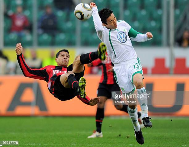 Makoto Hasebe of Wolfsburg is challenged by Cicero of Berlin during the Bundesliga match between VfL Wolfsburg and Hertha BSC Berlin at Volkswagen...
