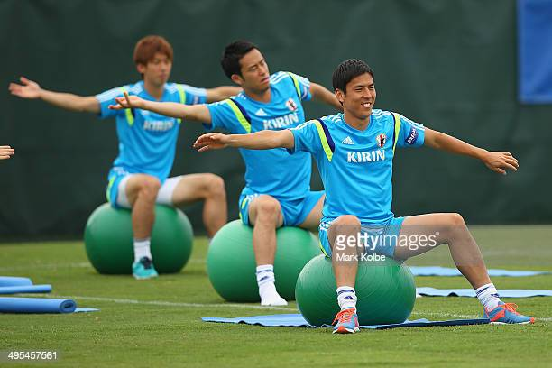 Makoto Hasebe stretches as he sits on a ball during a Japan training session at North Greenwood Recreation Aquatic Complex on June 3 2014 in...
