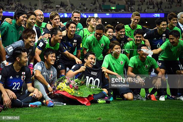 Makoto Hasebecaptain of Japan celebrates his 100th game with his team mates during the 2018 FIFA World Cup Qualifiers match between Japan and Iraq at...