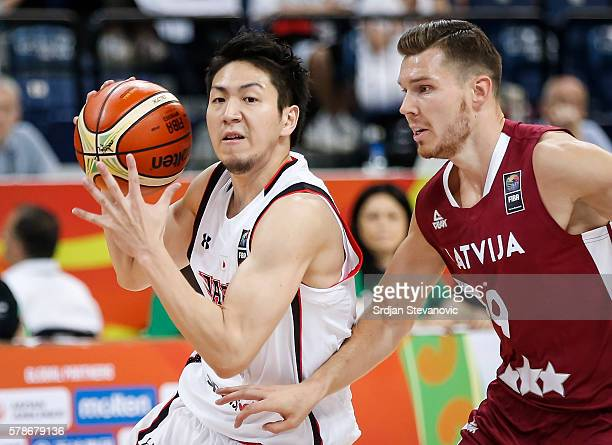Makoto Hiejima of Japan in action against Dairis Bertans of Latvia during the 2016 FIBA World Olympic Qualifying basketball Group A match between...