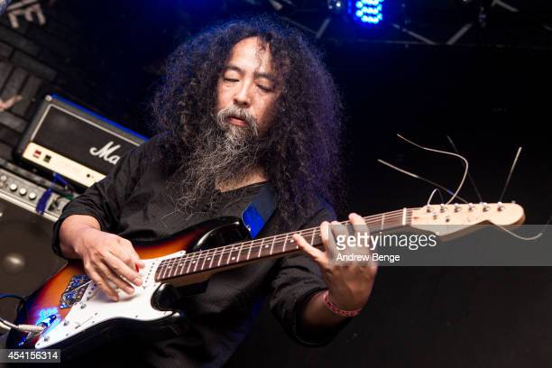 Makoto Kawabata of Acid Mothers Temple performs on stage at Brudenell Social Club on August 25 2014 in Leeds United Kingdom