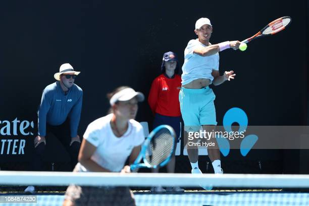 Makoto Ninomiya and Ben McLachlan of Japan during their Mixed Doubles match against Jessica Moore and Andrew Whittington of Australia during day six...