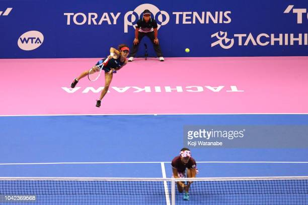 Makoto Ninomiya and Miyu Kato of Japan compete in the Doubles final against Barbora Strycova and Andrea Sestini Hlavackova of the Czech Republic on...