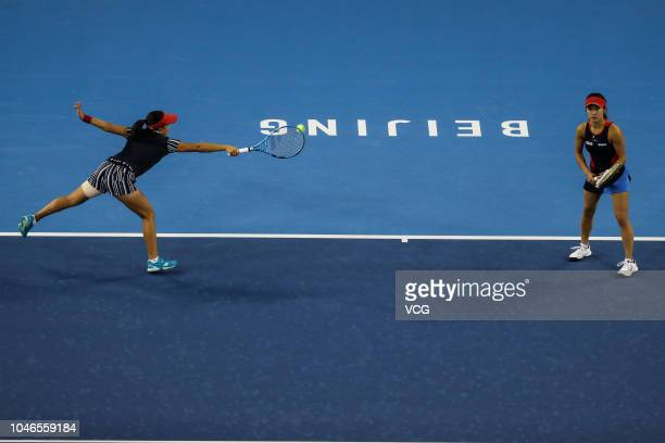 Makoto Ninomiya and Miyu Kato of Japan compete in the Women's Doubles first round match against Katarina Srebotnik of Slovenia and Lyudmyla Kichenok...