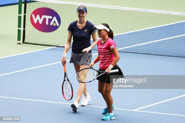 Makoto Ninomiya of Japan and Renata Voracova of Czech Republic celebrate Naomi Osaka and Mari Osaka of Japan during women's doubles match day three...