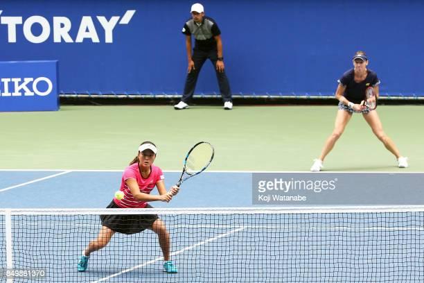 Makoto Ninomiya of Japan and Renata Voracova of Czech Republic competes against Naomi Osaka and Mari Osaka of Japan during women's doubles match day...