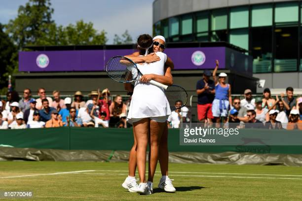 Makoto Ninomiya of Japan and Renata Voracova of the Czech Republic embrace during the Ladies Doubles second round match against Laura Robson of Great...