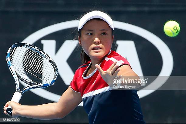 Makoto Ninomiya of Japan plays a forehand during her first round doubles match against Ekatarina Makarova and Elena Vesnina of Russia on day three of...
