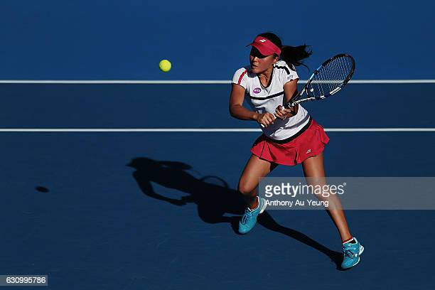 Makoto Ninomiya of Japan plays a volley with Shuko Aoyama of Japan in their doubles match against Kirsten Flipkens of Belgium and Jelena Ostapenko of...