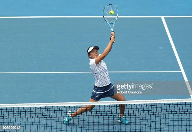 Makoto Ninomiya of Japan returns a shot during her semi finals doubles match againsts Alison Bai of Australia and Lizette Cabrera of Australia during...