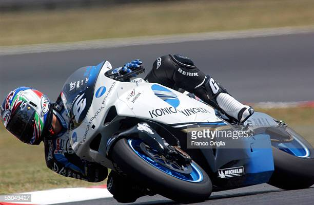 Makoto Tamada of Japan in action during the free practice session of the motorcycle Grand Prix of Catalonia at Montmelo Circuit on June 10 in...