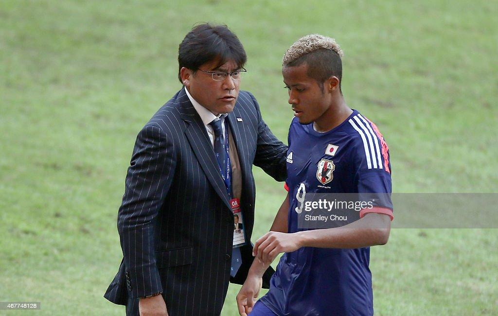 Makoto Teguramori, coach of Japan talks to Musashi Suzuki during the AFC U23 Championship Qualifier Group I match between Japan and Macau at Shah Alam Stadium on March 27, 2015 in Shah Alam, Malaysia.