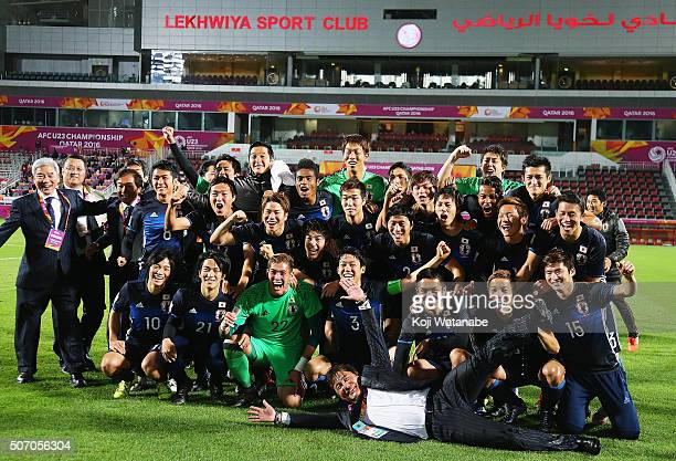 Makoto Teguramori Head coach of Japan and his team members and staffs pose for photographs after qualifying for the Rio de Janeiro Olympics by...