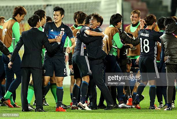 Makoto Teguramori Head Coach of Japan congraulated his players after winning the AFC U23 Championship semi final match between Japan and Iraq at the...