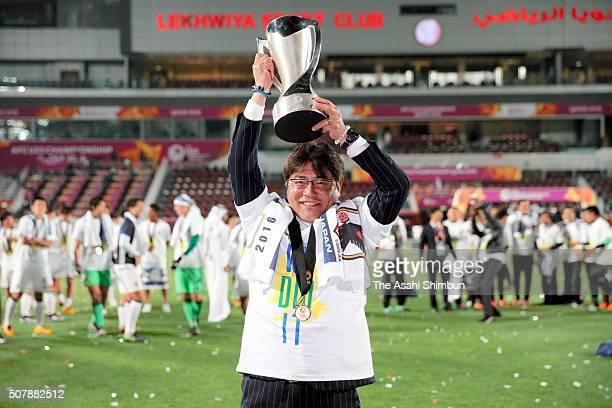 Makoto Teguramori Head coach of Japan lifts the trophy after winning the AFC U-23 Championship final match between South Korea and Japan at the...