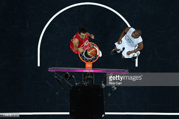 Makram Ben Romdhane of Tunisia dunks the ball over Derrick Obasohan of Nigeria during their Men's Basketball game on Day 2 of the London 2012 Olympic...