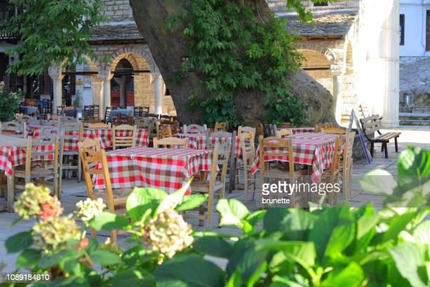 makrinitsa village square, pelion, greece - volos stock pictures, royalty-free photos & images