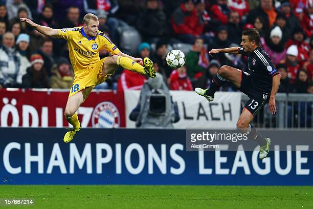Maksim Bordachev of Borisov is challenged by Rafinha of Muenchen during the UEFA Champions League Group F match between FC Bayern Muenchen and FC...