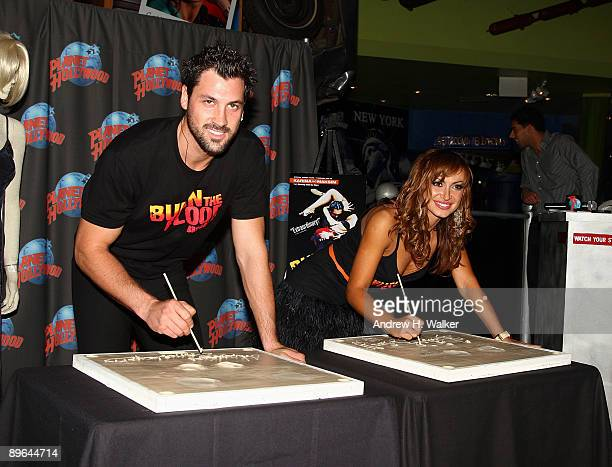 Maksim Chmerkovskiy and Karina Smirnoff promote Burn The Floor at Planet Hollywood Times Square on August 6 2009 in New York City