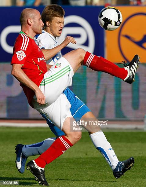 Maksim Kanunnikov of FC Zenit St Petersburg battles for the ball with Malkhaz Asatiani of FC Lokomotiv Moscow during the Russian Football League...