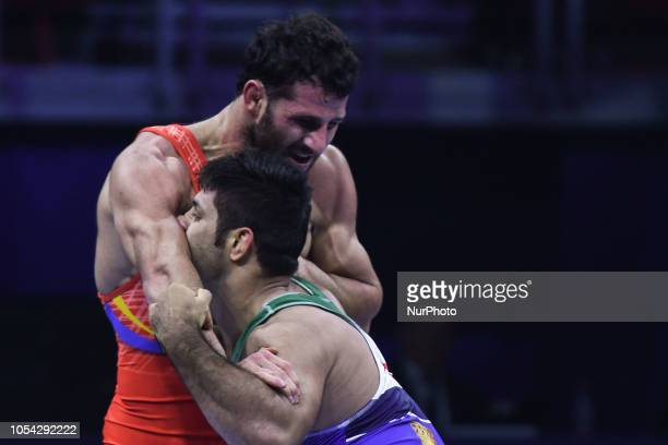 Maksim Manukyan of Armenia against Saeid Morad Abdvali of Iran a fight for a Bronze medal in men's GreecoRoman wrestling 82kg category at the World...
