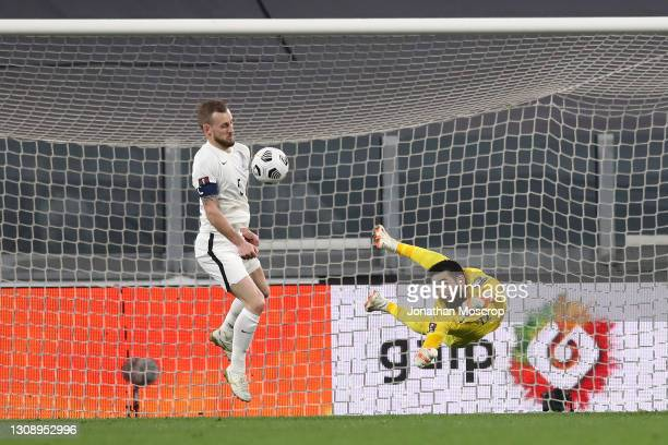 Maksim Medvedev of Azerbaijan scores an own goal for Portugal's first goal as Sahruddin Mehemmedeliyev of Azerbaijan attempts to save during the FIFA...