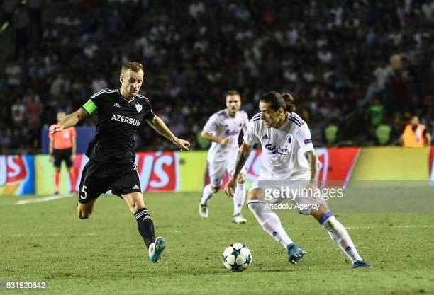 Maksim Medvedev of Qarabag Agdam in action against Federico Santander of FC Copenhagen during the UEFA Champions League playoff match between Qarabag...
