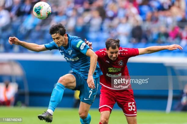 Maksim Osipenko of FC Tambov and Sardar Azmoun of FC Zenit Saint Petersburg vie for the ball during the Russian Premier League match between FC...