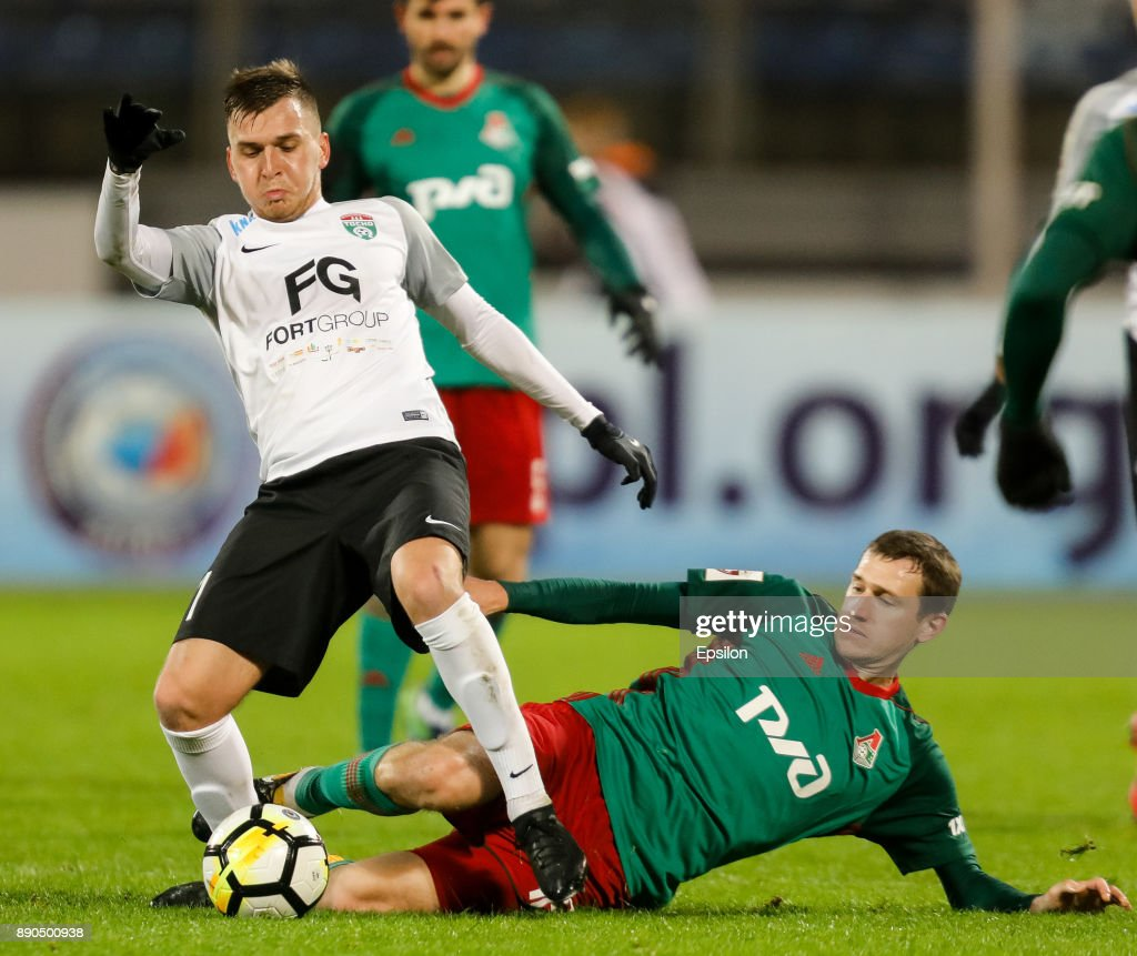 Maksim Paliyenko (L) of FC Tosno and Aleksandr Kolomeytsev of FC Lokomotiv Moscow vie for the ball during the Russian Football League match between FC Tosno and FC Lokomotiv Moscow on December 11, 2017 at Petrovsky Stadium in Saint Petersburg, Russia.