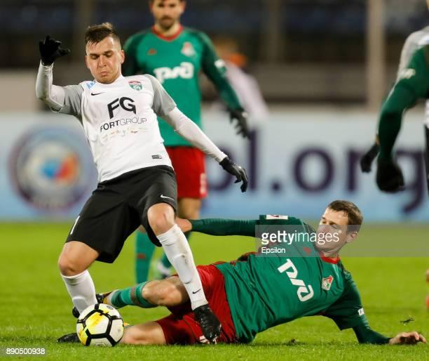 Maksim Paliyenko of FC Tosno and Aleksandr Kolomeytsev of FC Lokomotiv Moscow vie for the ball during the Russian Football League match between FC...