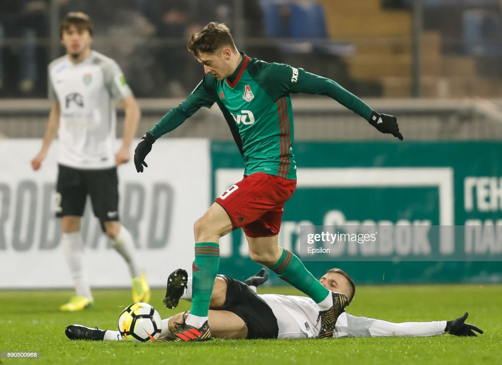 Maksim Paliyenko of FC Tosno and Aleksei Miranchuk (in front) of FC Lokomotiv Moscow vie for the ball during the Russian Football League match between FC Tosno and FC Lokomotiv Moscow on December 11, 2017 at Petrovsky Stadium in Saint Petersburg, Russia.