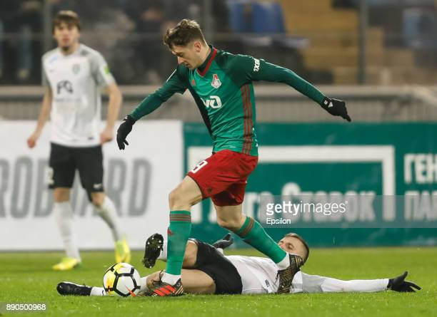Maksim Paliyenko of FC Tosno and Aleksei Miranchuk of FC Lokomotiv Moscow vie for the ball during the Russian Football League match between FC Tosno...